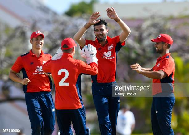 Sam Hain Alex Davies Saqib Mahmood and Brett DâOliveira of North celebrate the dismissal of Laurie Evans of South during the ECB North v South Series...