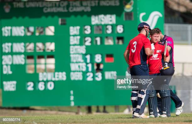 Sam Hain congratulates Alex Davies of North for his century during the ECB North v South Series warm up game between North and Northamptonshire at...