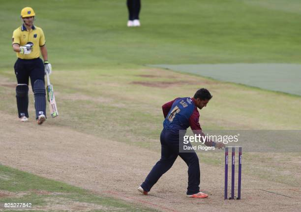 Sam Hain of Birmingham is run out by Saif Zaib during the NatWest T20 Blast match between Northamptonshire Steelbacks and Birmingham Bears at The...