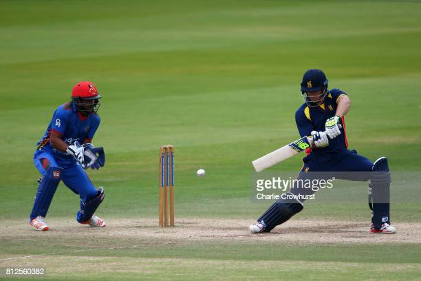 Sam Hain of MCC hits out while Afghanistan's Shafiqullah Shafaq tends the wicket during the MCC v Afghanistan cricket match at Lord's Cricket Ground...