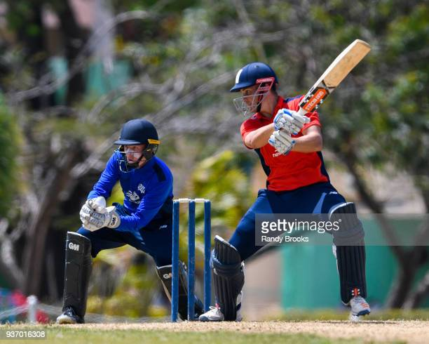 Sam Hain of North hits a 4 as Ollie Pope of South looks on during the ECB North v South Series match Three at 3Ws Oval on March 23 2018 in Bridgetown...