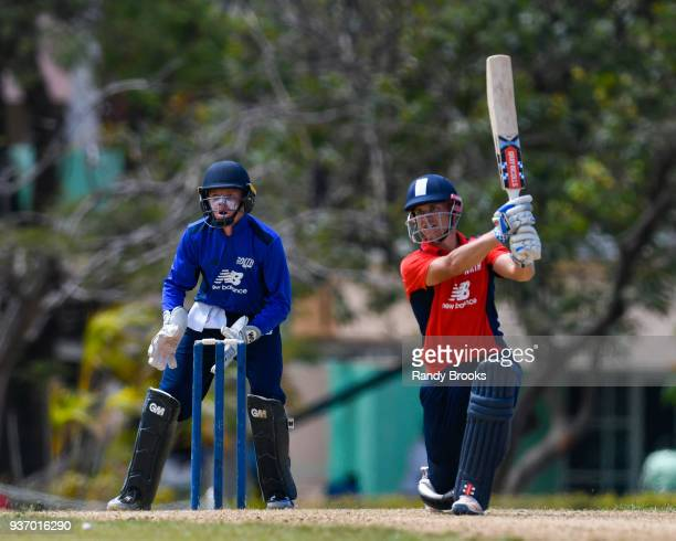 Sam Hain of North hits a 6 as Ollie Pope of South looks on during the ECB North v South Series match Three at 3Ws Oval on March 23 2018 in Bridgetown...