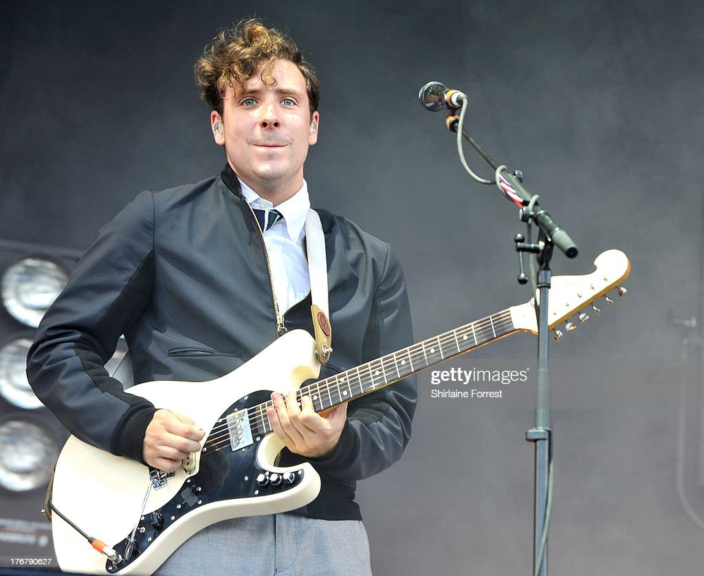 Sam Halliday of Two Door Cinema Club performs on day 2 of the V Festival at Weston Park on August 18, 2013 in Stafford, England.