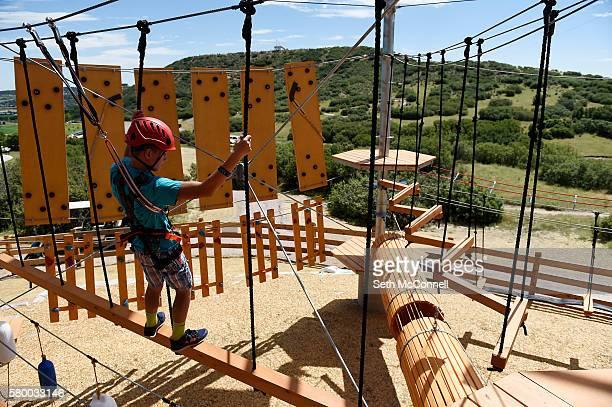 Sam Hamilton makes his way through an obstacle at Castle Rock Zip Line Tours in Castle Rock Colorado on July 22 2016 Castle Lines Zip Line Tours...