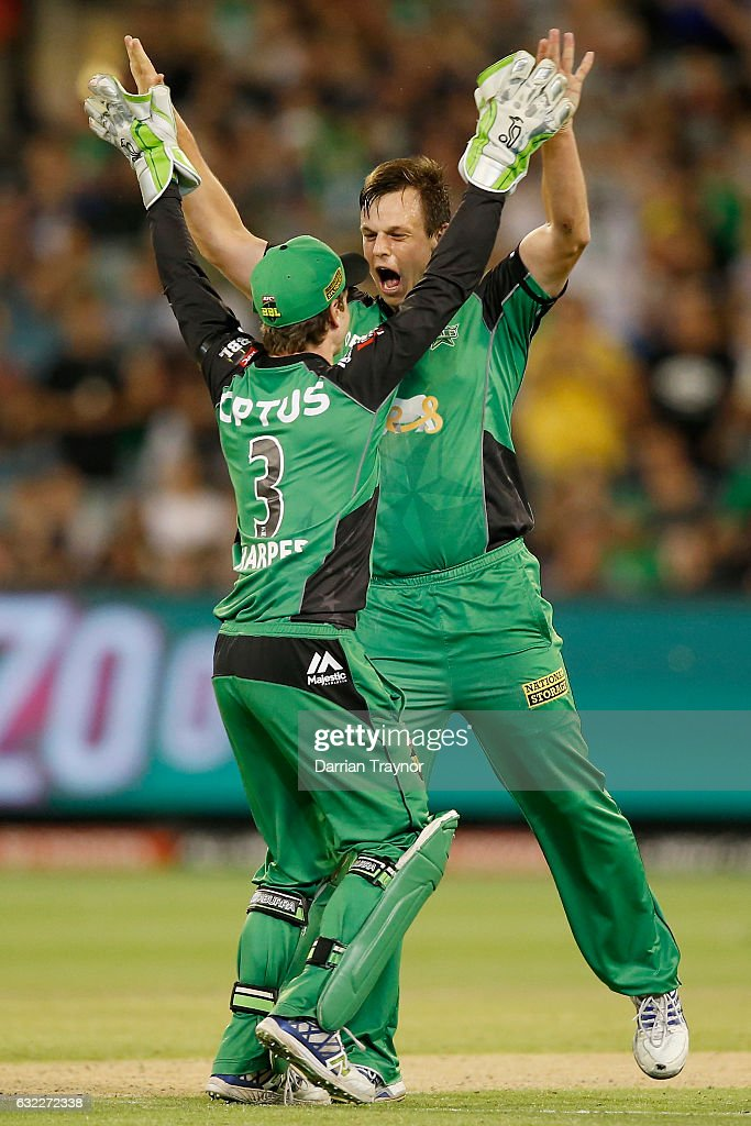 Sam Harper and Evan Gulbis of the Melbourne Stars celebrates the wicket of Daniel Hughes of the Sydney Sixers Starsduring the Big Bash League match between the Melbourne Stars and the Sydney Sixers at Melbourne Cricket Ground on January 21, 2017 in Melbourne, Australia.