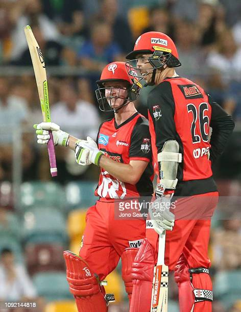 Sam Harper and Tom Cooper of the Renegades celebrate Harpers fifty funs during the Big Bash League match between the Brisbane Heat and the Melbourne...
