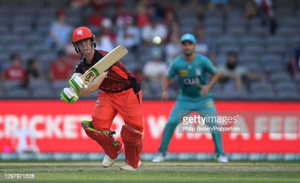 Sam Harper of Renegades hits out watched by Lewis Gregory during the Big Bash League match between the Melbourne Renegades and the Brisbane Heat at...