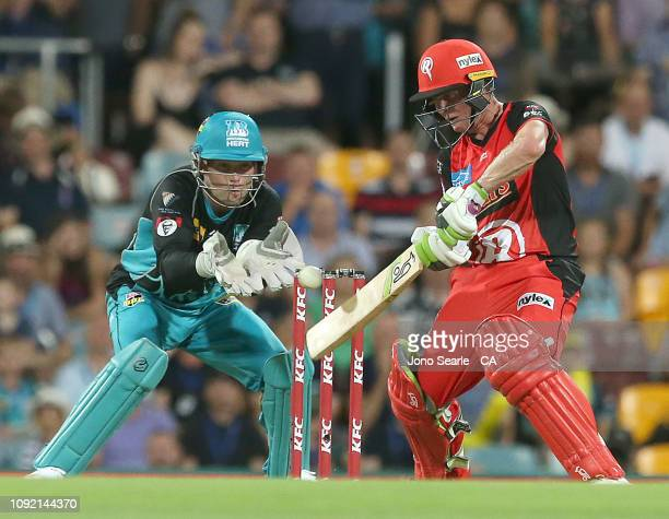 Sam Harper of the Renegades plays a shot during the Big Bash League match between the Brisbane Heat and the Melbourne Renegades at The Gabba on...