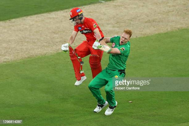 Sam Harperof the Renegades and Liam Hatcher of the Stars collide during the Big Bash League match between the Melbourne Stars and the Melbourne...