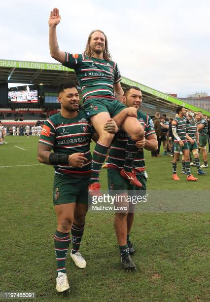 Sam Harrison of Leicester Tigers is carried around the pitch by Nephi Leatigaga of Leicester Tigers and Ellis Genge of Leicester Tigers after his...