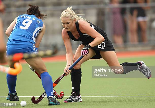 Sam Harrison of New Zealand has her path blocked by Young Mi Eum of Korea during the Women's match between the New Zealand Blacksticks and Korea at...