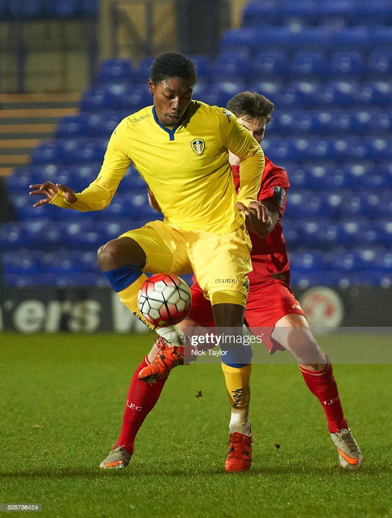 Sam Hart of Liverpool and Jordan Botaka of Leeds United in action during the Liverpool v Leeds United U21 Premier League Cup game at Prenton Park on January 19, 2016 in Birkenhead, England.