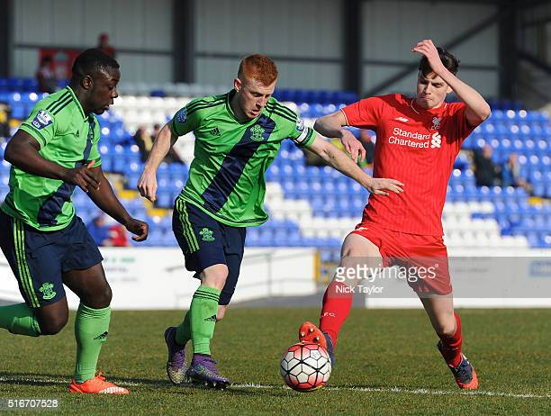 Sam Hart of Liverpool and Olufela Olomola and Harrison Reed of Southampton in action during the Liverpool v Southampton Barclays U21 Premier League...