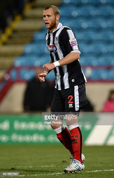 Sam Hatton of Grimsby Town during their FA Cup First Round Replay against Scunthorpe United at Glanford Park on November 19 2013 in Scunthorpe England