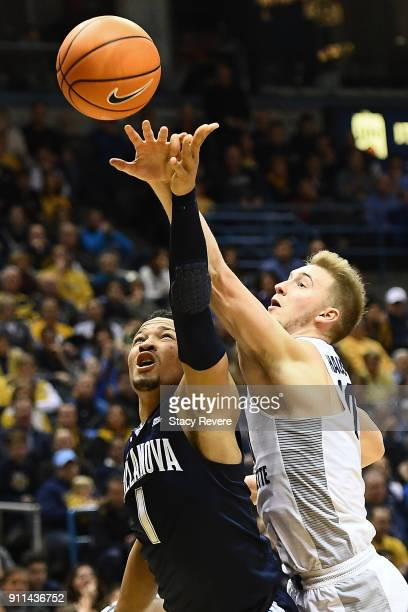Sam Hauser of the Marquette Golden Eagles blocks a shot by Jalen Brunson of the Villanova Wildcats during the first half at the BMO Harris Bradley...