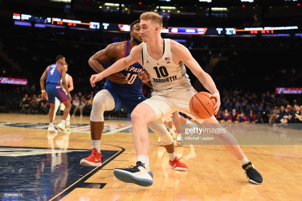 Sam Hauser #10 of the Marquette Golden Eagles dribbles by Tre'Darius McCallum #10 of the DePaul Blue Demons the first round of the Big East Men's Basketball Tournament at Madison Square Garden on March 7, 2018 in New York City. Photo by Mitchell Layton/Getty Images)
