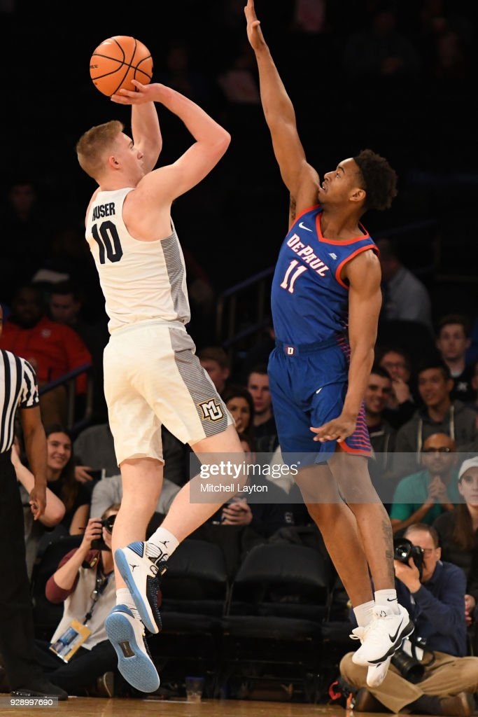 Sam Hauser #10 of the Marquette Golden Eagles takes a shot over Eli Cain #11 of the DePaul Blue Demons during the first round of the Big East Men's Basketball Tournament at Madison Square Garden on March 7, 2018 in New York City. Photo by Mitchell Layton/Getty Images)