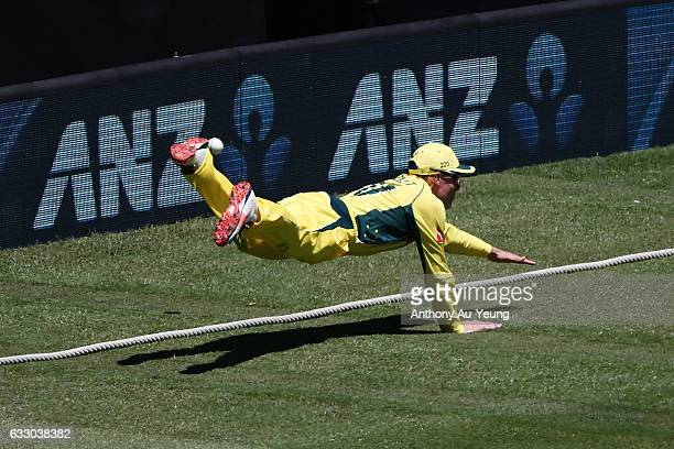 Sam Heazlett of Australia dives for a catch at the boundary during the first One Day International game between New Zealand and Australia at Eden...