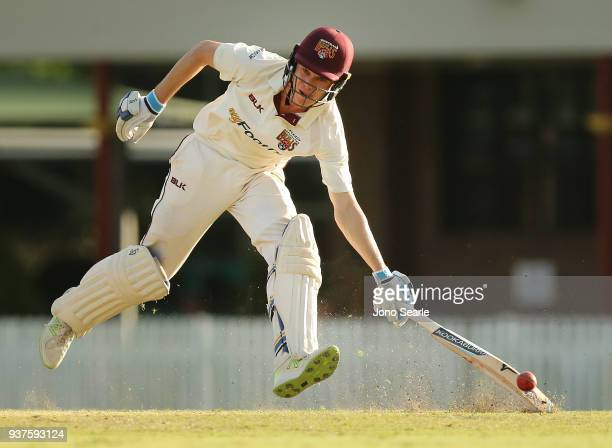 Sam Heazlett runs into his crease during day three of the Sheffield Shield final match between Queensland and Tasmania at Allan Border Field on March...