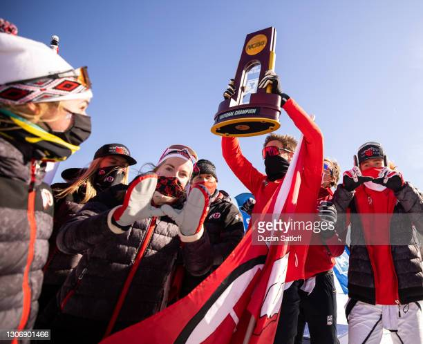 Sam Hendry of the University of Utah holds up the NCAA Skiing Championship after Utah won the title on March 13, 2021 in Jackson, New Hampshire.