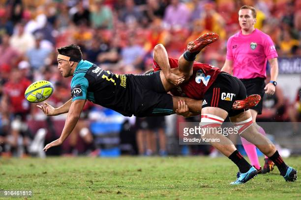 Sam Henwood of the Hurricanes is picked up in the tackle by Heiden BedwellCurtis of the Crusaders during the 2018 Global Tens semifinal match between...