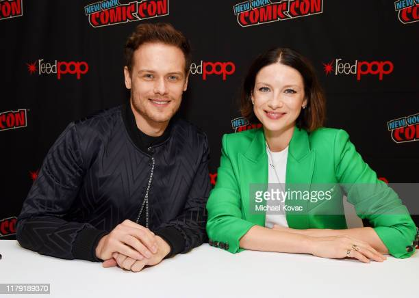 """Sam Heughan and Caitriona Balfe attend STARZ """"Outlander"""" meet and greet at NYCC 2019 on October 05, 2019 in New York City."""
