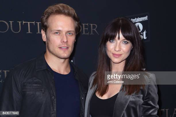 """Sam Heughan and Caitriona Balfe attend the New York premiere of """"Outlander"""" Season Three at Time Inc. On September 5, 2017 in New York City."""