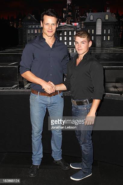 Sam Heughan and Kamran DarabiFord attend the 'Batman Live' BehindTheScenes Arena Tour Staples Center at Staples Center on September 27 2012 in Los...