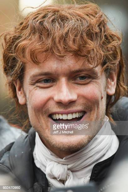 Sam Heughan from the TV series Outlander departs a filming location at St Andrew's Square on March 15 2018 in Glasgow Scotland Dozens of fans have...