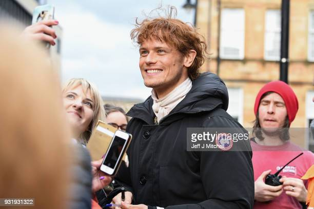 Sam Heughan from the TV series Outlander meets fans who were waiting in St Andrew's Square on March 14 2018 in Glasgow Scotland Dozens of fans have...