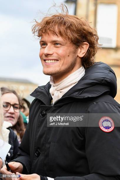 Sam Heughan from the TV series Outlander meets fans who were waiting in St Andrew's Square on March 14 2018 in GlasgowScotland Dozens of fans have...