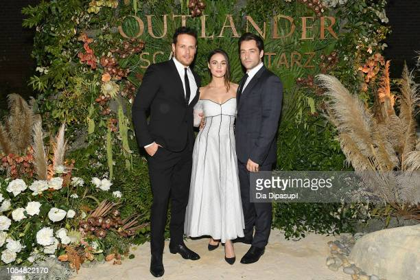 Sam Heughan Sophie Skelton and Richard Rankin attend the 21st SCAD Savannah Film Festival 'Outlander' Season Four reception on October 28 2018 in...