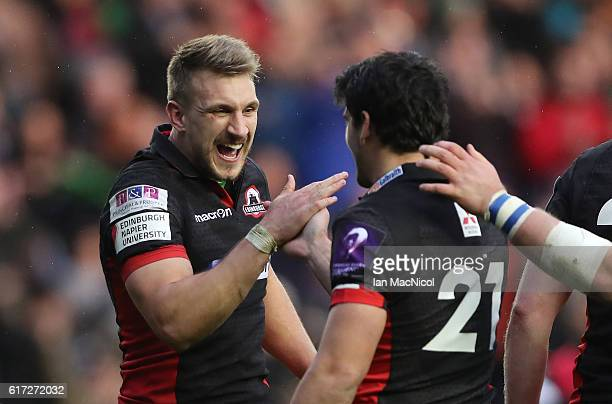 Sam Hidalgo-Clyne and Tom Brown of Edinburgh celebrate at full time during the European Rugby Challenge Cup match between Edinburgh and Harlequins at...