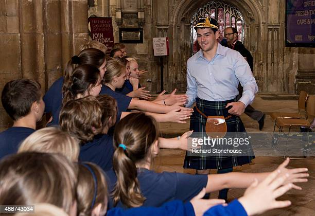 Sam Hidalgo-Clyne high fives school children after receiving his World Rugby Cup Cap at Gloucester Cathedral during RWC 2015 Welcome Ceremony -...