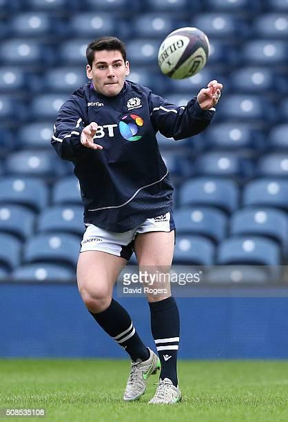 Sam Hidalgo-Clyne passes the ball during the Scotland captain's run at Murrayfield Stadium on February 5, 2016 in Edinburgh, Scotland.