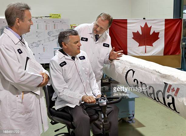 Sam Higson, Shuttle programs director for Brampton's MDA Space Missions, RIGHT, gives Ontario Lieutentant-Governor David Onley, SEATED, a quick...