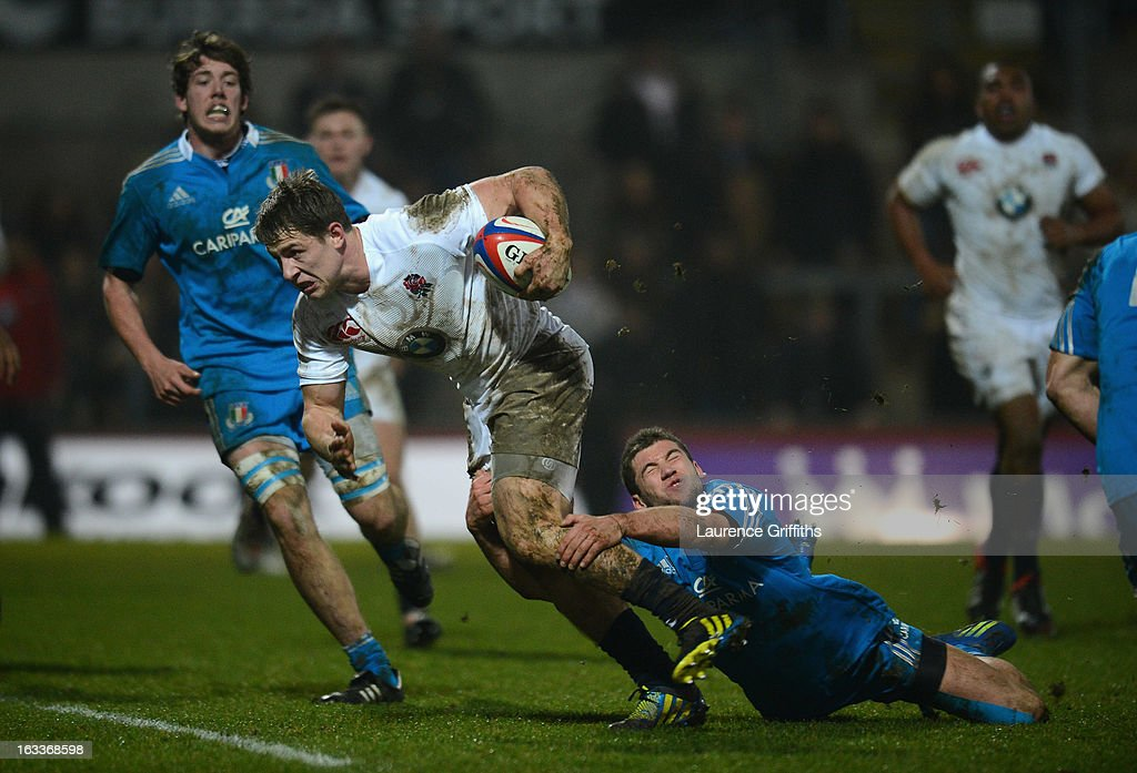 Sam Hill of England breaks from Angelo Esposito of Italy to score a first half try during the International match between England U20 and Italy U20 at Franklin's Gardens on March 8, 2013 in Northampton, England.