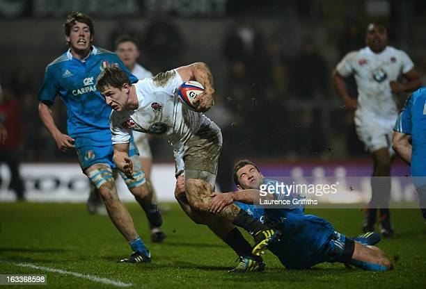 Sam Hill of England breaks from Angelo Esposito of Italy to score a first half try during the International match between England U20 and Italy U20...