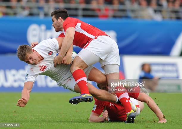 Sam Hill of England is tackled during the IRB Junior World Championship Final match between England U20 and Wales U20 at Stade de la Rabine on June...