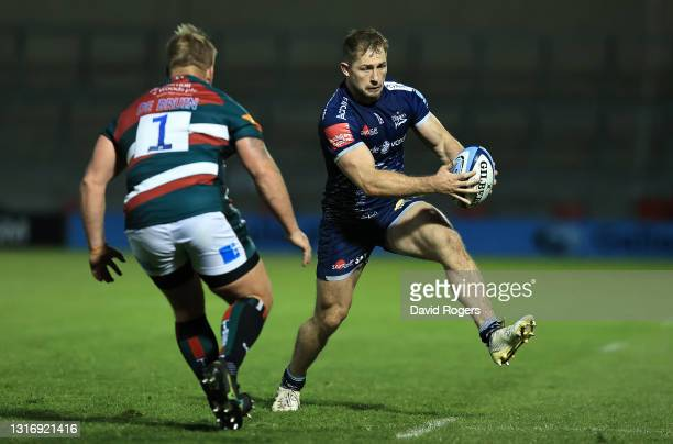 Sam Hill of Sale Sharks takes on Luan de Bruin during the Gallagher Premiership Rugby match between Sale Sharks and Leicester Tigers at AJ Bell...
