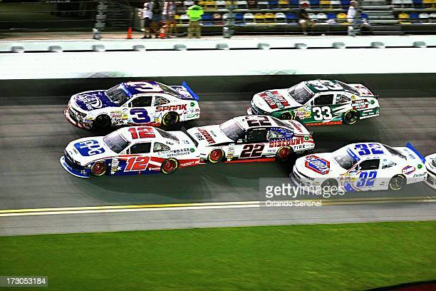 Sam Hornish and Joey Logano lead the pack in the NASCAR Nationwide series' Subway Firecracker 250 at Daytona International Speedway on Friday July 5...