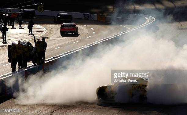 Sam Hornish Jr driver of the Alliance Truck Parts Dodge celebrates with a burnout after winning the NASCAR Nationwide Series WYPALL 200 at Phoenix...