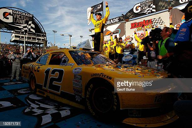 Sam Hornish Jr driver of the Alliance Truck Parts Dodge celebrates in victory lane after winning the NASCAR Nationwide Series WYPALL 200 at Phoenix...