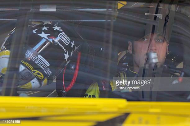 Sam Hornish Jr driver of the Alliance Truck Parts Dodge sits in his car during practice for the NASCAR Nationwide Series Sam's Town 300 at Las Vegas...