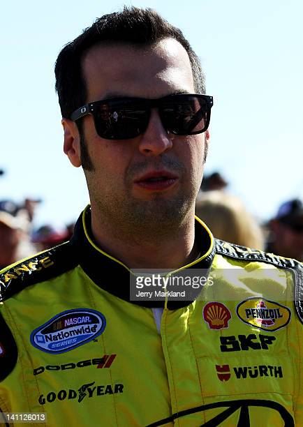 Sam Hornish Jr driver of the Alliance Truck Parts Dodge stands on the grid prior to the NASCAR Nationwide Series Sam's Town 300 at Las Vegas Motor...