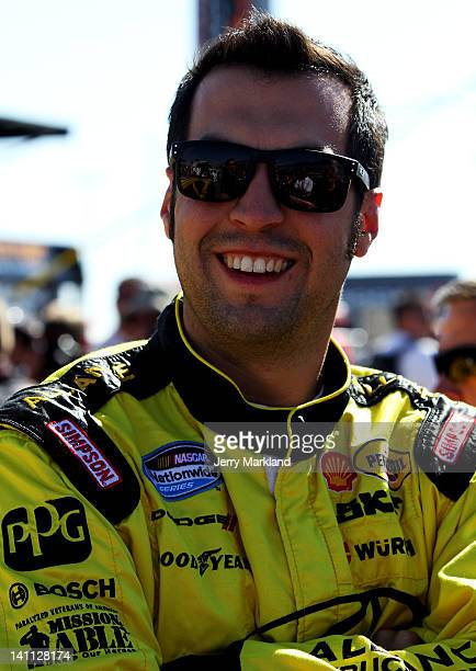 Sam Hornish Jr driver of the Alliance Truck Parts Dodge stands on the grid before the NASCAR Nationwide Series Sam's Town 300 at Las Vegas Motor...