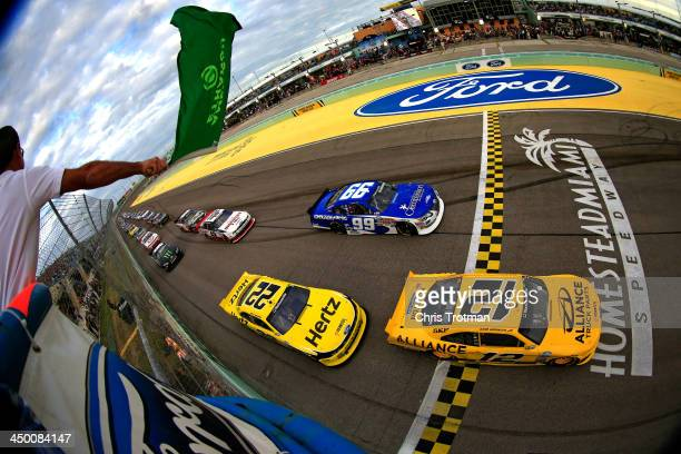 Sam Hornish Jr driver of the Alliance Truck Parts Ford leads the field to the green flag to start the NASCAR Nationwide Series Ford EcoBoost 300 at...