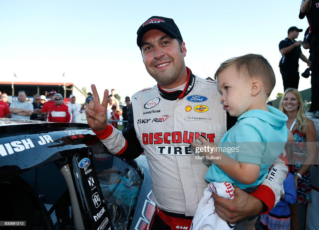 Sam Hornish Jr., driver of the #22 Discount Tire Ford, poses with the winners sticker after winning the NASCAR XFINITY Series Mid-Ohio Challenge at Mid-Ohio Sports Car Course on August 12, 2017 in Lexington, Ohio.
