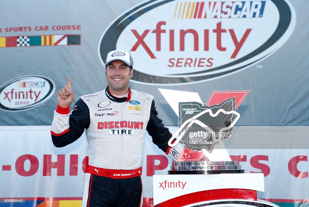 Sam Hornish Jr., driver of the #22 Discount Tire Ford, poses with the trophy during the NASCAR XFINITY Series Mid-Ohio Challenge at Mid-Ohio Sports Car Course on August 12, 2017 in Lexington, Ohio.