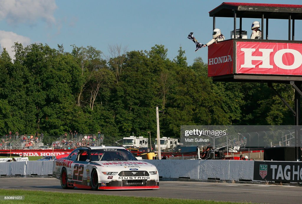 Sam Hornish Jr., driver of the #22 Discount Tire Ford, takes the checkered flag to win the NASCAR XFINITY Series Mid-Ohio Challenge at Mid-Ohio Sports Car Course on August 12, 2017 in Lexington, Ohio.